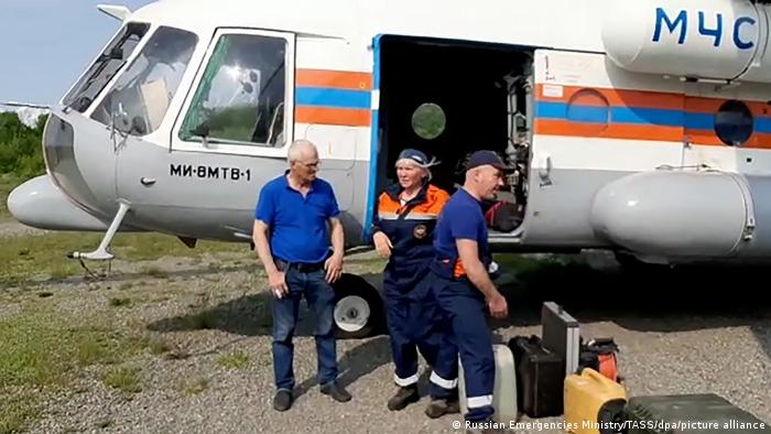 A search and rescue team boarding an Emercom Mil Mi-8 helicopter for a flight to Palana, Kamchatka Territory to take part in a search operation for a missing Antonov An-26 passenger aircraft