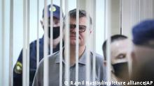 Viktor Babariko, the former head of Russia-owned Belgazprombank, stands inside a cage in a court room in Minsk, Belarus, Tuesday, July 6, 2021. The Supreme Court in Belarus has sentenced a former contender in the 2020 presidential race to 14 years in prison on corruption charges in a case that has been widely seen as politically motivated. Viktor Babariko, the former chief executive of a Russia-owned bank, aspired to challenge Belarus' authoritarian president Alexander Lukashenko in last year's election. (Ramil Nasibulin/BelTA Pool Photo via AP)