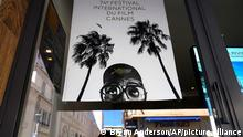 Official Cannes signage is seen in a store window ahead of the 74th international film festival, Cannes, southern France, July 5, 2021. The Cannes film festival runs from July 6 - July 17, 2021. (AP Photo/ Brynn Anderson)