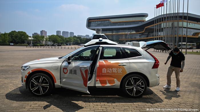A driver in a Didi Chuxing autonomous taxi in Shanghai