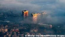 A picture taken from Vitosha mountain on November 27, 2020, shows buildings above clouds in an area with a high level of air pollution in Sofia, Bulgaria. - Winter smog season has settled in and Bulgaria's soaring coronavirus death rate, one of Europe's highest, is prompting experts to warn about a compound health risk from air pollution and Covid-19. (Photo by NIKOLAY DOYCHINOV / AFP) (Photo by NIKOLAY DOYCHINOV/AFP via Getty Images)