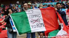 LONDON, ENGLAND - JULY 06: A fan of Italy holds a flag with the words It's coming to Rome prior to the UEFA Euro 2020 Championship Semi-final match between Italy and Spain at Wembley Stadium on July 06, 2021 in London, England. (Photo by Carl Recine - Pool/Getty Images)