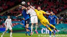 Soccer Football - Euro 2020 - Semi Final - Italy v Spain - Wembley Stadium, London, Britain - July 6, 2021 Italy's Gianluigi Donnarumma and Leonardo Bonucci in action with Spain's Alvaro Morata Pool via REUTERS/Frank Augstein