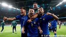 Soccer Football - Euro 2020 - Semi Final - Italy v Spain - Wembley Stadium, London, Britain - July 6, 2021 Italy's Jorginho with teammates celebrate after winning the penalty shoot-out Pool via REUTERS/Carl Recine