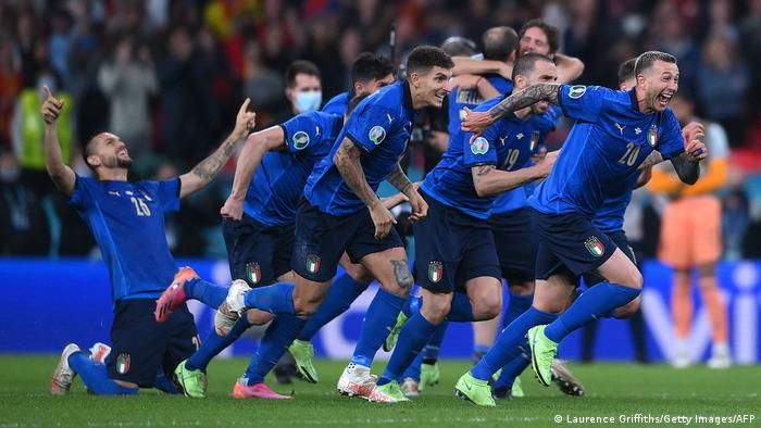 Italy's players celebrate winning the semifinal penalty shoot-out against Spain