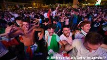 Supporters of Italy's national football team celebrate during the UEFA EURO 2020 semi-final football match between Italy and Spain, as the match is displayed on a giant screen, at the Piazza del Popolo, in Rome, on July 6, 2021. (Photo by Andreas SOLARO / AFP) (Photo by ANDREAS SOLARO/AFP via Getty Images)