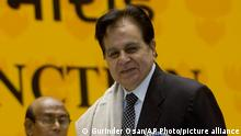 """FILE - In this Sept. 2, 2008, file photo, veteran Bollywood actor Dilip Kumar, right, receives a Lifetime Achievement award at the 54th National Film Award ceremony in New Delhi, India. Kumar, hailed as the """"Tragedy King"""" and one of Hindi cinema's greatest actors, died Wednesday, July 7, 2021 in a Mumbai hospital after a prolonged illness. He was 98. (AP Photo/Gurinder Osan, File)"""