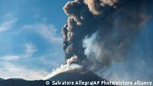04.07.21 *** An ash column rises during an eruption of Mt. Etna, Europe's largest active volcano, as seen from the Bove Valley of Etna Park, on the eastern slope of Mt. Etna, in Sicily, southern Italy, Sunday, July 4, 2021. Since Feb. 16, 2021, Mt. Etna has begun a series of eruptive episodes. (AP Photo/Salvatore Allegra)