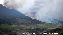 Smoke rising from fire at McKay Creek is seen from Lillooet, British Columbia, Canada June 30, 2021 in this picture obtained from social media on July 1, 2021. Sid Bones-Scotchman/via REUTERS THIS IMAGE HAS BEEN SUPPLIED BY A THIRD PARTY. MANDATORY CREDIT. NO RESALES. NO ARCHIVES.