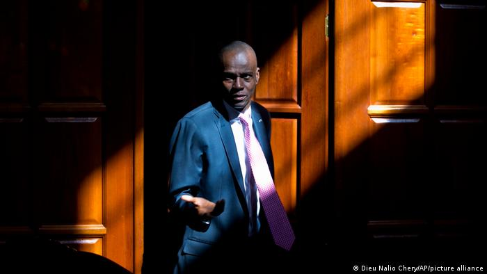 Jovenel Moise gestures in front of a door at his home in Petion-Ville, a suburg of Port-au-Prince
