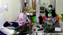 FILE PHOTO: People rest on veld beds inside the emergency ward for the coronavirus disease (COVID-19) patients at a government-run hospital in Jakarta, Indonesia, June 29, 2021. REUTERS/Willy Kurniawan/File Photo