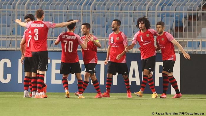 Istiklol's players celebrate their goal during the AFC Champions League match against Saudi's Al-Hilal