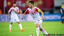 Akhtam Nazarov of Tajikistan controls the ball during their football friendly match against China in Guangzhou, in China's southern Guangdong province on June 11, 2019. (Photo by STR / AFP) / China OUT (Photo credit should read STR/AFP via Getty Images)