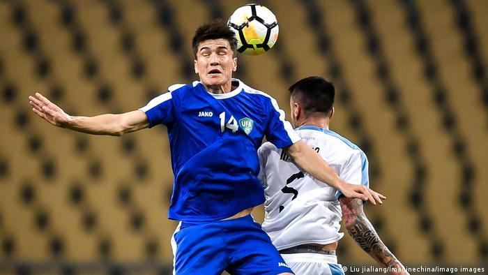 Ukraine's Eldor Shomurodov challenging for a header