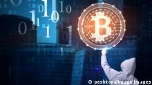 Back view of young hacker pointing at glowing bitcoin sign on blurry city background. with binary code. Web safety and cryptocurrency concept. Double exposure