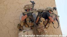 (210706) -- KANDAHAR, July 6, 2021 (Xinhua) -- Afghan security force members take part in a fight against Taliban militants in Panjwai district of Kandahar province, southern Afghanistan, July 5, 2021. (Photo by Sananullah Seiam/Xinhua)
