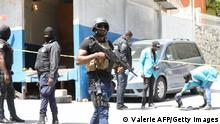 TOPSHOT - Members of the Haitian police and forensics look for evidence outside of the presidential residence on July 7, 2021 in Port-au-Prince, Haiti. - Haiti President Jovenel Moise was assassinated and his wife wounded early July 7, 2021 in an attack at their home, the interim prime minister announced, an act that risks further destabilizing the Caribbean nation beset by gang violence and political volatility. Claude Joseph said he was now in charge of the country and urged the public to remain calm, while insisting the police and army would ensure the population's safety.The capital Port-au-prince as quiet on Wednesday morning with no extra security forces on patrol, witnesses reported. (Photo by VALERIE BAERISWYL / AFP) (Photo by VALERIE BAERISWYL/AFP via Getty Images)