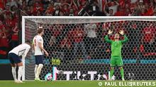 Soccer Football - Euro 2020 - Semi Final - England v Denmark - Wembley Stadium, London, Britain - July 7, 2021 England's Harry Kane prepares to take a penalty before Denmark's Kasper Schmeichel saves and Kane scores their second goal from the rebound Pool via REUTERS/Paul Ellis