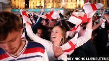 Soccer Football - Euro 2020 - Fans gather for England v Denmark - Trafalgar Square, London, Britain - July 7, 2021 England fans celebrate after the match REUTERS/Henry Nicholls