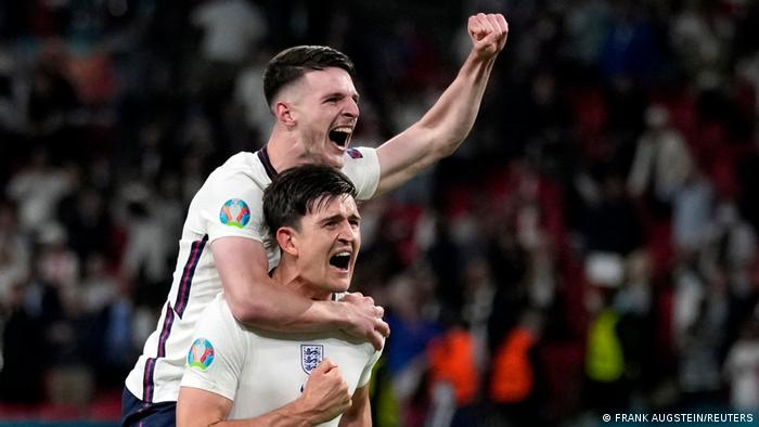 England's Harry Maguire with England's Declan Rice celebrate after the semi-final against Denmark. July 7, Wembley Stadium, London.
