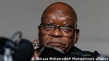 Former president Jacob Zuma addresses the press at his home in Nkandla, KwaZulu-Natal Natal Province, Sunday, July 4, 2021. Zuma told hundreds of supporters gathered outside his rural estate that he is appealing his 15-month prison sentence and impending arrest by police. South Africa's top court, the Constitutional Court, last week sentenced Zuma to prison for defying a court order that he should testify before a commission investigating allegations of rampant corruption when he was president from 2009 to 2018. (AP Photo/Shiraaz Mohamed)