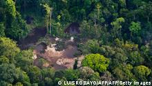 This aerial view shows an illegal gold mine along of Timbiqui River on August 9, 2016 in rural area of Timbiqui, departament of Cauca, Colombia. - In a joint operation of the Colombian Armed Forces, two people were captured and 26 excavators and two dredges were destroyed, according to the authorities belonging to the ELN and other organized armed groups. They have calculated that about 18 kilos of gold were extracted daily, with one kilo of this gold worth approximately 38 thousand dollars. (Photo by Luis ROBAYO / AFP) (Photo by LUIS ROBAYO/AFP via Getty Images)