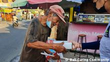 Donation for people in needs amid Covid-19 restriction in Bali, Indonesia People in Bali, Indonesia, help each other during the emergency public movement restriction to curb Covid-19, by giving free meals and renovating houses to those who are in need.