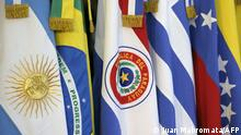 (FILES) In this file photo taken on June 29, 2012, the flags of the countries that are part of Mercosur are seen during the XLIII Mercosur presidential summit in Mendoza, Argentina. - Uruguay informed its Mercosur partners on July 7, 2021, that it would negotiate trade agreements with third countries, which so far required the consensus of the other three members (Argentina, Brazil and Paraguay). (Photo by Juan MABROMATA / AFP)