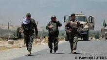 Afghan National Army (ANA) soldiers patrol the area near a checkpoint recaptured from the Taliban, in the Alishing district of Laghman province, Afghanistan July 8, 2021.REUTERS/Parwiz