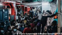 July 5, 2021.*** Migrants rest aboard the Ocean Viking after being rescued during a search and rescue (SAR) operation in the Mediterranean Sea, July 5, 2021. Picture taken July 5, 2021. Flavio Gasperini/SOS Mediterranee/Handout via REUTERS ATTENTION EDITORS - THIS IMAGE HAS BEEN SUPPLIED BY A THIRD PARTY. NO RESALES. NO ARCHIVES. MANDATORY CREDIT