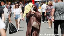A tourist takes a picture in central Kyiv, Ukraine June 24, 2021. Picture taken June 24, 2021. REUTERS/Gleb Garanich