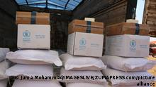 July 4, 2021: Aleppo, Syria, 04 July 2021. Aid is delivered to displaced civilians in a camp in Darat Izza, northwest of Aleppo. Currently humanitarian aid reaches the rebel-held area in northwest Syria through the Bab Al-Hawa border crossing, which the UN Security Council approved in 2014, three years after the start of the Syrian conflict. The UN is due to hold a vote on July 10 to discuss the renewal of the authorisation for aid to transit through the crossing. Local and international humanitarian organisations have highlighted that the crossing is the only lifeline for northwest Syria and warned of a major humanitarian catastrophe for the people living in the region, especially for those displaced, if the border was shut (Credit Image: © Juma Mohammad/IMAGESLIVE via ZUMA Wire