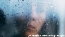 Unrecognizable person standing behind wet glass Copyright: xAlbertoxMenendezx