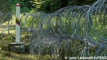 09.07.2021 A razor wire barrier is installed on border with Belarus in Druskininkai, Lithuania July 9, 2021. REUTERS/Janis Laizans