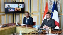 French President Emmanuel Macron and Niger's President Mohamed Bazoum attend a video summit with leaders of G5 Sahel countries after France's decision last month to reduce French anti-terror troops in West Africa, at the Elysee presidential Palace in Paris, Friday July 9, 2021. (Stephane de Sakutin, Pool photo via AP)