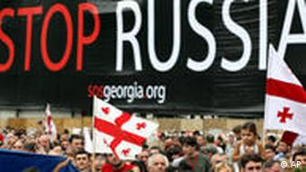 Georgians attend a protest action in Tbilisi, Georgia, opposing the Russian military presence in the breakaway provinces of South Ossetia and Abkhazia