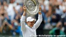 Australia's Ashleigh Barty holds the winner's Venus Rosewater Dish trophy after winning her women's singles match against Czech Republic's Karolina Pliskova on the twelfth day of the 2021 Wimbledon Championships at The All England Tennis Club in Wimbledon, southwest London, on July 10, 2021. - RESTRICTED TO EDITORIAL USE (Photo by PETER NICHOLLS / POOL / AFP) / RESTRICTED TO EDITORIAL USE (Photo by PETER NICHOLLS/POOL/AFP via Getty Images)