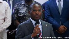 Haiti's interim Prime Minister Claude Joseph addresses the audience after suspects in the assassination of President Jovenel Moise, who was shot dead early Wednesday at his home, were shown to the media, in Port-au-Prince, Haiti July 8, 2021. REUTERS/Estailove St-Val NO RESALES. NO ARCHIVES