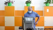 A man votes during a snap parliamentary election, at a polling station in Sofia, Bulgaria, July 11, 2021. REUTERS/Spasiyana Sergieva