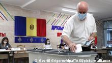 CHISINAU, MOLDOVA - JULY 11, 2021: A man casts his ballot in the snap parliamentary election at Polling Station 1/71. Twenty political parties, 2 electoral blocs and an independent candidate take part in the 2021 Moldovan parliamentary election. Gavriil Grigorov/TASS