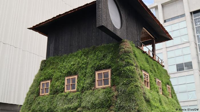 Tea house art work covered in grass and moss