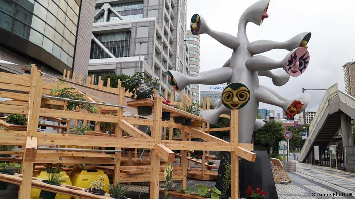 Teppei Fujiwara's Street Garden Theater consisting of wooden structures that resemble planting pots and rows of theater seats at the same time