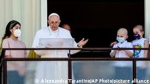 Pope Francis appears with young oncologic patients on a balcony of the Agostino Gemelli Polyclinic in Rome, Sunday, July 11, 2021, where he is recovering from intestinal surgery, for the traditional Sunday blessing and Angelus prayer. Pope Francis is 84 and had a part of his colon removed a week ago. (AP Photo/Alessandra Tarantino)