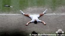 Serbia's Novak Djokovic celebrates winning against Italy's Matteo Berrettini during their men's singles final match on the thirteenth day of the 2021 Wimbledon Championships at The All England Tennis Club in Wimbledon, southwest London, on July 11, 2021. - RESTRICTED TO EDITORIAL USE (Photo by PETER NICHOLLS / POOL / AFP) / RESTRICTED TO EDITORIAL USE (Photo by PETER NICHOLLS/POOL/AFP via Getty Images)
