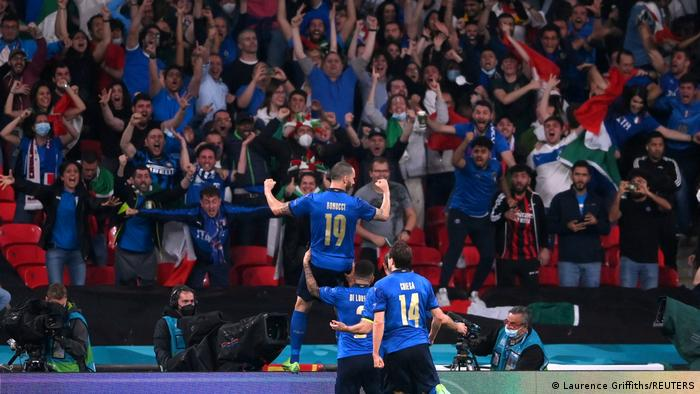Italian players celebrate their equalizer with their fans