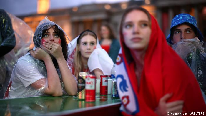 Nervous England fans at a fan zone at Trafalgar Square in London