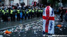 Soccer Football - Euro 2020 - Final - Fans gather for Italy v England - London, Britain - July 11, 2021 Police officers stand guard as England fans gather during the match Action Images via Reuters/Paul Childs