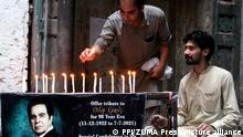 July 7, 2021, Pakistan: PESHAWAR, PAKISTAN, JUL 07: Fans lighting candles next to the ancestral home of cinema .legend Muhammad Yusuf Khan (Dilip Kumar) who passed away after a protracted illness in .Mumbai, during ceremony held at his residency in Peshawar on Wednesday, July 07, 2021. Dilip .Kumar, one of India's earliest and most famous film actors, has died in Mumbai at the age of 98. .A veritable legend, Kumar acted in more than 65 films over nearly five decades, playing roles .that ranged from the iconic to the endearing. Dilip Kumar was born Yusuf Khan in December .1922 in Peshawar. Like some of his Muslim contemporaries, he took on a Hindu name Dilip .Kumar when he joined the Hindi film industry. (Credit Image: © PPI via ZUMA Wire