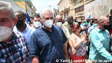 Cuban President Miguel Diaz-Canel is seen during a demonstration held by citizens to demand improvements in the country, in San Antonio de los Banos, Cuba, on July 11, 2021. - Thousands of Cubans marched this Sunday, July 11, through the streets of the small town of San Antonio de los Banos in an unprecedented protest against the government, according to videos of fans posted on the internet. (Photo by Yamil LAGE / AFP) (Photo by YAMIL LAGE/AFP via Getty Images)