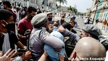 TOPSHOT - A man is arrested during a demonstration against the government of Cuban President Miguel Diaz-Canel in Havana, on July 11, 2021. - Thousands of Cubans took part in rare protests Sunday against the communist government, marching through a town chanting Down with the dictatorship and We want liberty. (Photo by ADALBERTO ROQUE / AFP)